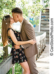 Young couple in love posing on camera