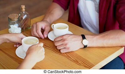 Young couple in love sitting in a cafe and having coffee -...