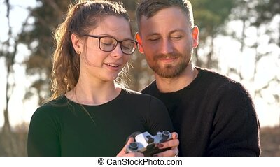 Young couple in love taking photo of themself on a film camera