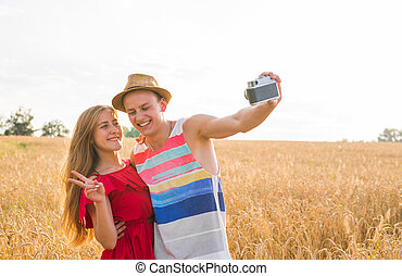 Young couple in love taking selfie