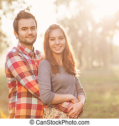 Young couple in love walking in the autumn park