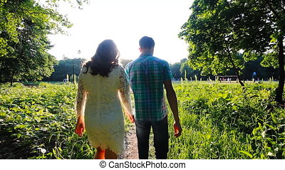 Young couple in love walking slow-motion glide shot