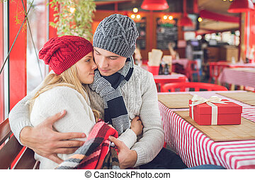 Young couple in love with a gift