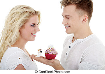 young couple in love with cupcake