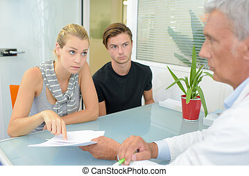 Young couple in meeting with doctor
