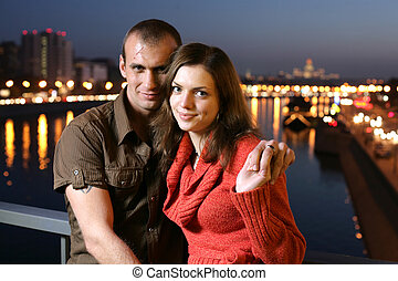 Young couple in night city