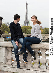 young couple in Paris on the bridge