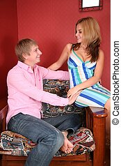young couple in red room
