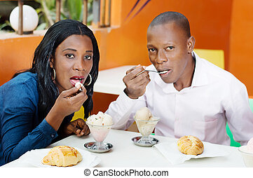Young couple in restaurant.