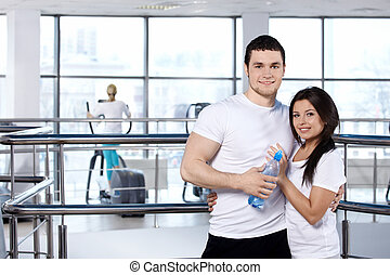 Young couple in sports club