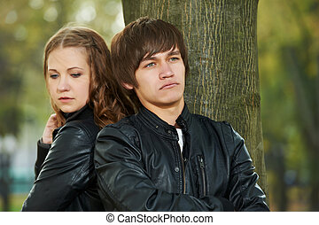 young couple in stress relationship - conflict and emotional...