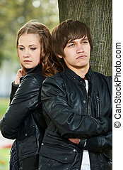 young couple in stress relationship - conflict offence and...