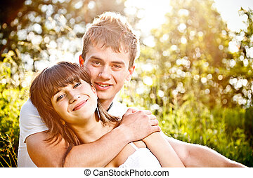 Young couple in sunset