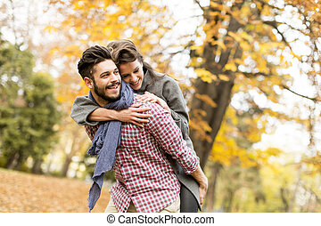 Young couple in the autumn forest