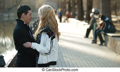 Young Couple In The City - Young couple walking along the...