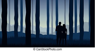 young couple in the forest blue nature landscape