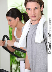 Young couple in the gym