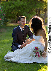 Young couple in the park after wedding