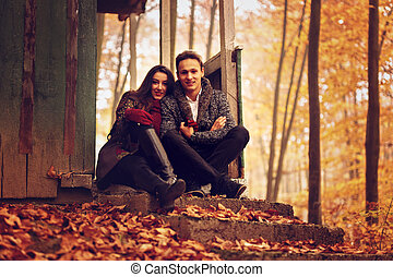 Young Couple In The Park Autumn Concept