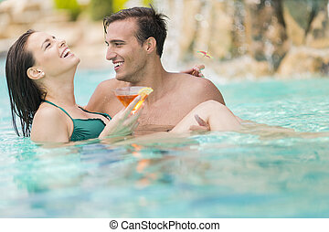 Young couple in the pool