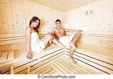 Young couple in the sauna - Young couple relaxing in the...