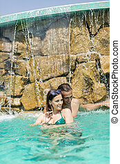 Young couple in the swimming pool