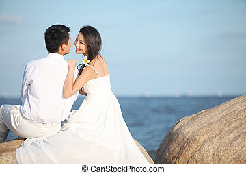 Young Couple in Wedding Dress on beach