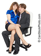 Young couple in white chair