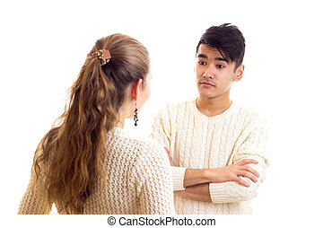Young couple in white sweaters talking - Young woman with...
