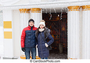 Young couple in winter clothes posing outdoors