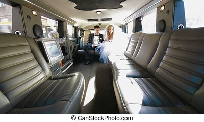 Young Couple Inside Limo