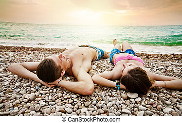 Young couple is relaxing on the beach