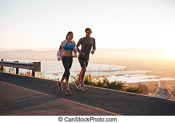Young couple jogging early in morning