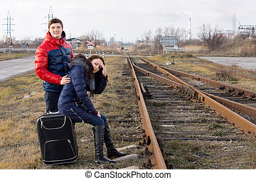 Young couple keeping a watch for the train
