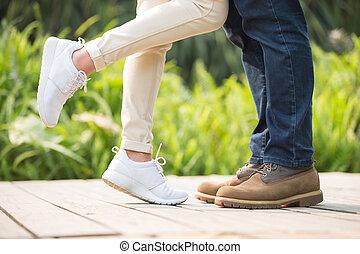 young couple kiss and hug