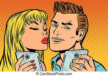 young couple kiss selfie on smartphone