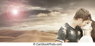 young couple kisses in the desert