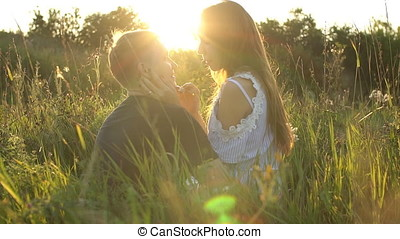 Young couple kissing in a field. concept about passion and love