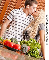 Young Couple Kissing in Kitchen