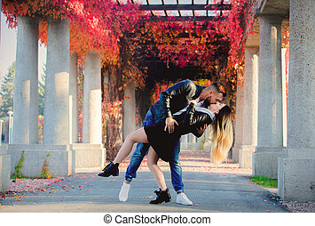 Young couple kissing on alley