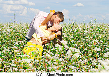 Young couple kissing - Young couple in love who kissing at...