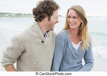 Young couple laughing at beach
