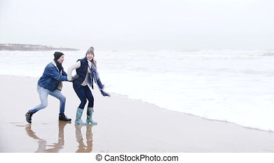 Young Couple Laughing In The Sea In Winter - A young couple...