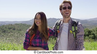 Young couple laughing while hiking
