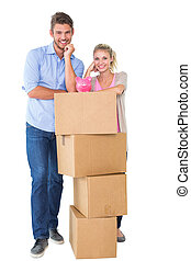 Young couple leaning on boxes