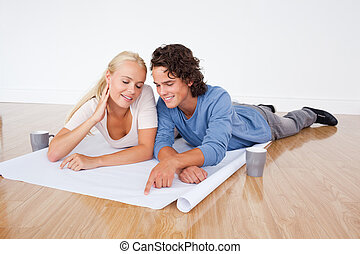 Young couple looking at a plan