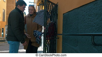 Young couple looking at children clothing outdoor