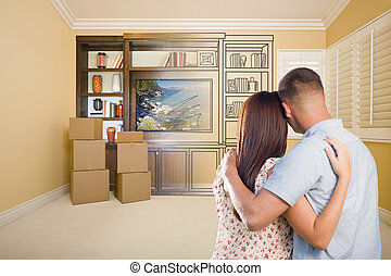 Young Couple Looking At Drawing of Entertainment Unit In...