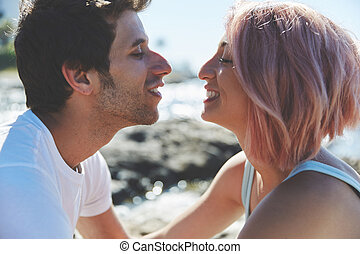 Young couple looking at each other smiling