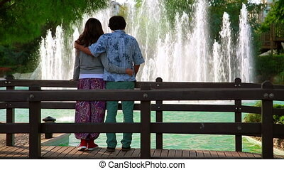 Young couple looking at fountain
